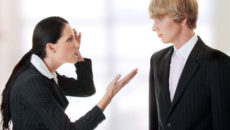 Work Colleagues arguing (woman shouting on man)