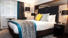 Deluxe bedroom at Crowne Plaza Felbridge (med)