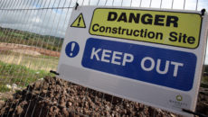 PAULTON, ENGLAND - APRIL 26:  A sign warns of danger on a fence surrounding land that is being prepared for new houses to be built on a brownfield site close to the greenbelt of the village of Paulton on April 26, 2012 near Bristol, England. Figures released yesterday showed the UK's economy had slipped into a double-dip recession for the first time since the 1970s and the decline was led in the main by a slump in the construction industry.  (Photo by Matt Cardy/Getty Images)