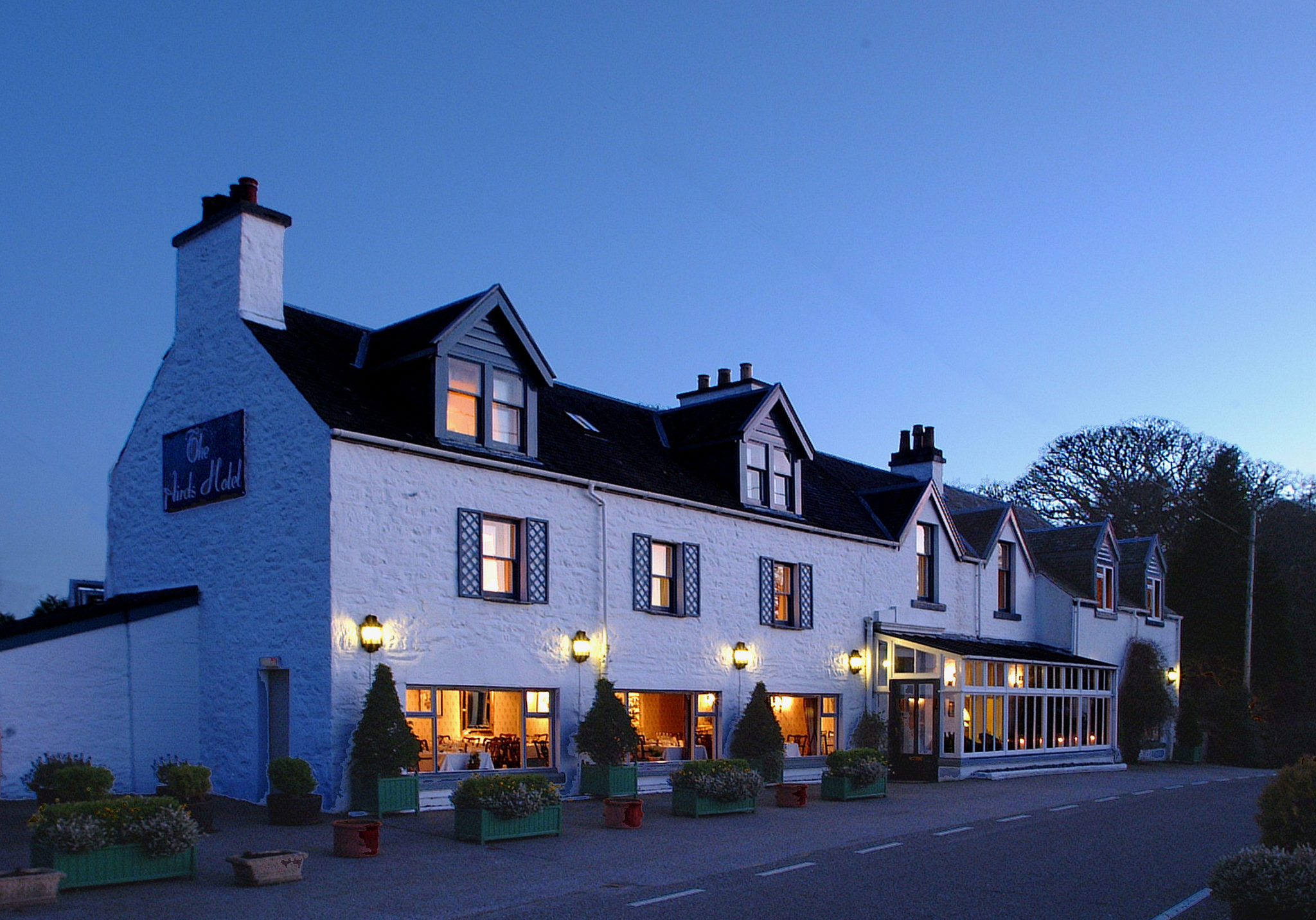 Airds, exterior at dusk