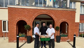 Woodland Park Hotel Delivering scones to hospice